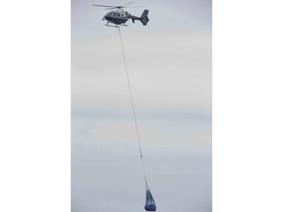 An OPP helicopter lifts a refrigerator from the beach below a Lake Erie bluff east of Port Burwell on Tuesday, May 7, 2019. Earlier, the helicopter lifted a body from the beach off Lakeshore Line east of Stafford Road. Derek Ruttan/The London Free Press