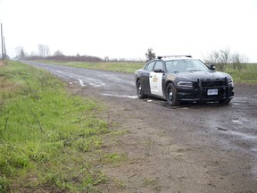 Lakeshore Line at Strafford Road was still closed Wednesday as the OPP continued their investigation into the discovery of human remains on a lakeside bluff at Port Burwell. (DEREK RUTTAN, The London Free Press)