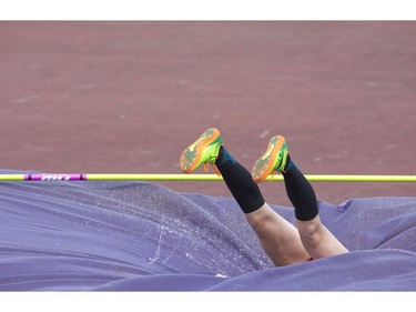 Emma Bernier of St. Anne's Catholic secondary school high jumper sinks into the mat during the WOSSAA track and field championship at TD Stadium in London on Friday. She took home the gold medal in the junior girls high jump with a personal best of 1.57 meters. (Derek Ruttan/The London Free Press)