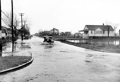 HISTORIC-April 5/1947-Motorist churning his way through flood water pouring onto the highway at Lauzon rd. and Clairview Ave, in Riverside. A section of Highway#2 were reported blocked by water earlier today. The rainfall was expected to continue. (The Windsor Star-FILE) Used online