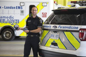 Dustin Carter , the Middlesex-London Paramedic Service's superintendent of Community Paramedicine, displays some of the blue tooth enabled self management devices used by people in London. (Derek Ruttan/The London Free Press)