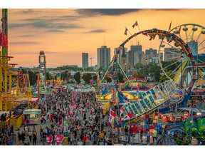 Some 156,000 lights brighten the Midway and 75 rides attract guests at the Western Fair.