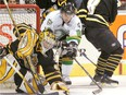 London Knights Patrick Kane pulls away from Sarnia's Jared Gomes and Christian Steingraber (8) as he tries to pounce on a rebound covered by Sting goalie Parker VanBuskirk during their OHL preseason opener on Sept. 1, 2007 at the John Labatt Centre. (Files)
