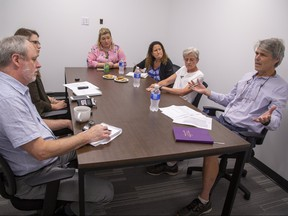 Clockwise from bottom left--London Free Press journalists Randy Richmond and Megan Stacey discuss the city's employment situation with panelists Amanda Wilcox, Carol Stewart, Sue Wilson and Don Kerr in London, Ont. on Wednesday July 24, 2019. Derek Ruttan/The London Free Press/Postmedia Network