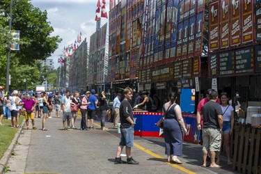 Hungry people line up to purchase lunch at The London Rib Fest and Craft Beer Festival in Victoria Park in London, Ont. on Monday August 5, 2019. Derek Ruttan/The London Free Press/Postmedia Network