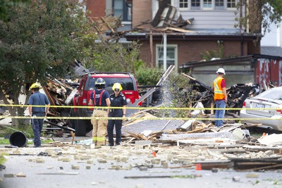 London fire inspectors and the Ontario Fire Marshall survey the scene at 450 Woodman after a car being driven the wrong way of Queens Ave crashed into a home at 450 Woodman Avenue and caused a huge natural gas leak leading to a massive explosion that demolished the house as well as severely damaged several others in the old east village in London, Ont.  Photograph taken on Thursday August 15, 2019.  Mike Hensen/The London Free Press/Postmedia Network