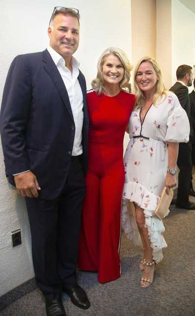 Eric and Kina Lindros embrace Christine Simpson at Logan Couture's All-In for Brain Research charity event at Centennial Hall in London, Ont.  Mike Hensen/The London Free Press/Postmedia Network