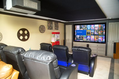 The entertainment room features a large Runco projector for perfect picture reproduction as well as comfortable seating. (Mike Hensen/The London Free Press)
