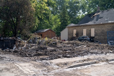 Crews continue to clean up the destruction on Woodman Avenue Saturday morning. Three homes on the street have been demolished.