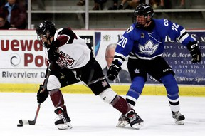 Chatham Maroons' Aleksa Babic (47) skates away from London Nationals' Griffin Sinden (20) in the third period at Chatham Memorial Arena in Chatham, Ont., on Sunday, Sept. 15, 2019. Mark Malone/Chatham Daily News/Postmedia Network