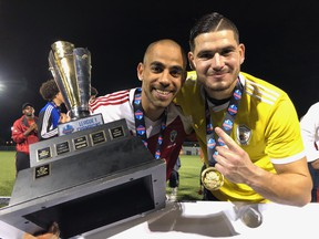 Scarborough Masters Futbol player Anwar Al-Sawl and goalkeeper Spiridon Koskinas celebrate their League1 Ontario championship win over FC London Friday at Ontario Soccer Centre in Woodbridge (Paul Vanderhoeven/The London Free Press)