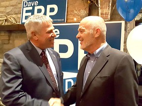 Conservative Dave Epp is greeted by retiring Conservative MP Dave Van Kesteren on Monday after he took the lead in the Chatham-Kent-Leamington riding to keep the seat Tory blue. (Trevor Terfloth/Chatham Daily News)