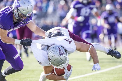 Western Mustang Zach Lindley was called for horse collaring on this tackle of Ottawa Gee Gee Dylan St. Pierre during their game in London, Ont. on Saturday October 19, 2019. Derek Ruttan/The London Free Press/Postmedia Network