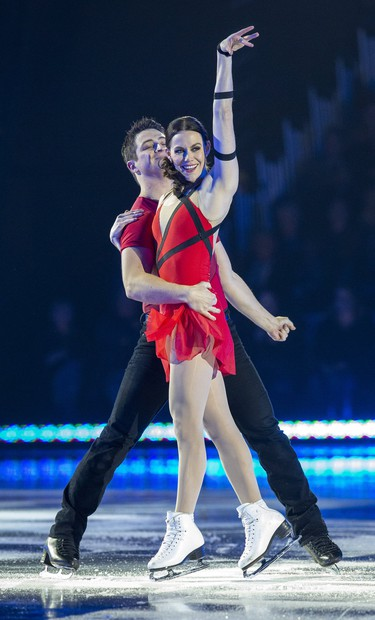 Scott Moir and Tessa Virtue perform during Rock The Rink in London, Ont. on Wednesday, Oct. 30, 2019. (Derek Ruttan/The London Free Press)