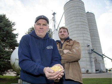 Dan Veldman and his son Josh need propane to operate the corn dryer behind them in Embro, Shipments are few and far between because of the strike at CN Rail. (Derek Ruttan/The London Free Press)