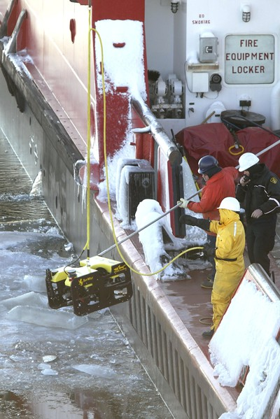 Plane crash investigators aboard the Canadian Coast Guard vessel Samuel Risley lower a remote-operated vehicle into Lake Erie near the submerged wreckage of Cessna Caravan which crashed west of Pelee Island on January 17, 2004 killing ten people.  (The Windsor Star - NICK BRANCACCIO)