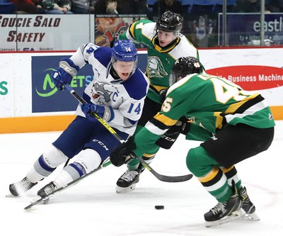 Macauley Carson, left, of the Sudbury Wolves, attempts to elude Gerard Keane, of the London Knights, during OHL action at the Sudbury Community Arena in Sudbury, Ont. on Friday December 20, 2019. John Lappa/Sudbury Star/Postmedia Network