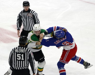 London Knights Cole Tymkin gets hit during a fight with Kitchener Rangers Arber Xhekaj in London, Ont. on Saturday December 28, 2019. (Greg Colgan/Postmedia Network)