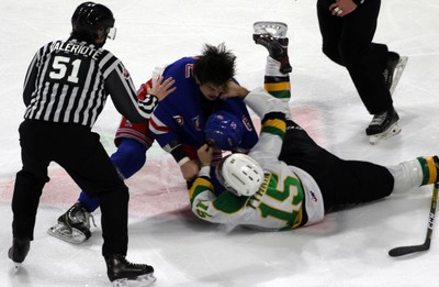 London Knights Cole Tymkin hits Kitchener Rangers Arber Xhekaj during a fight with in London, Ont. on Saturday December 28, 2019. (Greg Colgan/Postmedia Network)