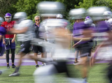 Head coach Greg Marshall puts players through their paces during Western Mustangs football practice at TD Stadium in London on Thursday August 22, 2019. (Derek Ruttan/The London Free Press)
