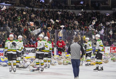 Stuffed animals rain down on the ice surface at Budweiser Gardens during the second period of an OHL hockey game between the London Knights and Owen Sound Attack in London, Ont. on Friday December 6, 2019. The annual Teddy Bear Toss provides thousands of toys for needy children that will be distributed by the Salvation Army. Derek Ruttan/The London Free Press/Postmedia Network