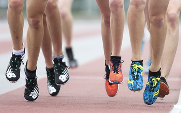 Junior boys run in the 3000m race during the WOSSAA track and field championship at TD Stadium in London on Friday May 24, 2019. (Derek Ruttan/The London Free Press)