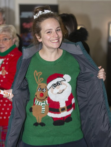 Alicia Thompson gets in the spirit at Ugly Sweater Night at the London Knights game against the Sarnia Sting at Budweiser Gardens in London on Friday. (Mike Hensen/The London Free Press)