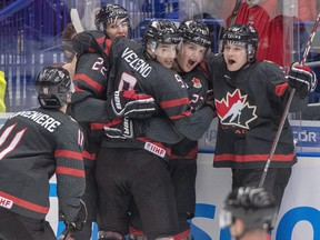 Canada's Dylan Cozens (22, back left) celebrates with teammates (left to right) Alexis Lafreniere, Joe Veleno, Barrett Hayton and Calen Addison after scoring the first goal against Russia during second period action in the gold medal game at the World Junior Hockey Championships, Sunday, Jan. 5, 2020 in Ostrava, Czech Republic. THE CANADIAN PRESS/Ryan Remiorz