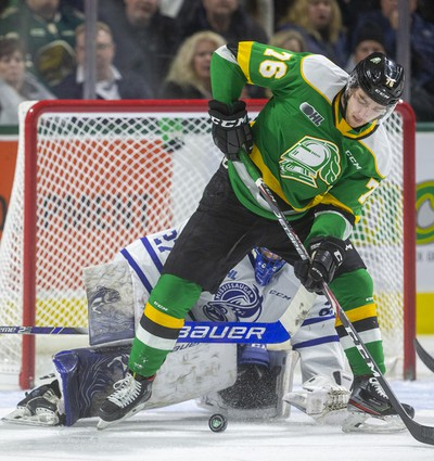 Billy Moskal tries to dig the puck out from his skates in front of Mississauga goalie Kai Edmonds during the first period of their game Friday night at Budweiser Gardens in London, Ont.  Photograph taken on Friday January 3, 2020.  Mike Hensen/The London Free Press/Postmedia Network