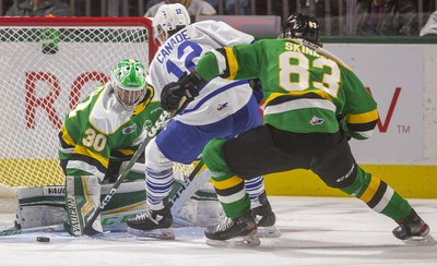 Hunter Skinner of the Knights tries to disrupt Mississauga's Nicholas Canade as he sweeps in on Brett Brochu in net for London during the first period of their game Friday night at Budweiser Gardens in London, Ont.  Photograph taken on Friday January 3, 2020.  Mike Hensen/The London Free Press/Postmedia Network