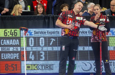 Ben Hebert and Rachel Homan of Team Canada try to figure out what went wrong after falling behind 7-0 after two ends to Europe's mixed doubles duo of Eve Muirhead and Bobbie Lammie at the Continental Cup curling competition Saturday January 11, 2020 at the Western Fair Sports Centre. The match ended after 7 ends with Europe winning 10-2. Mike Hensen/The London Free Press/Postmedia Network