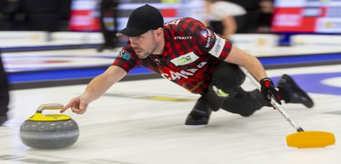 John Epping delivers a rock during the mixed doubles competition at the Continental Cup curling event Saturday January 11, 2020 at the Western Fair Sports Centre. Epping and partner Lisa Weagle lost 8-4 to Melanie Barbezat and Peter De Cruz. Mike Hensen/The London Free Press/Postmedia Network