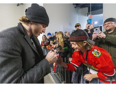 Patrick Kane signs autographs before having his No. 88 for the London Knights retired at Budweiser Gardens on Friday. (Mike Hensen/The London Free Press)