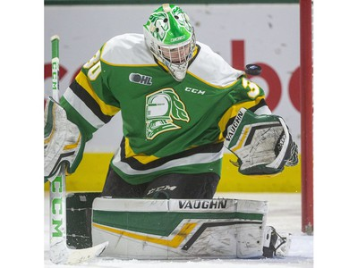 Brett Brochu of the Knights juggles a puck that ended up in his crease behind him, but was saved by Markus Phillips as the London Knights host the Hamilton Bulldogs at Budweiser Gardens on Friday Jan. 24, 2020.   (Mike Hensen/The London Free Press)