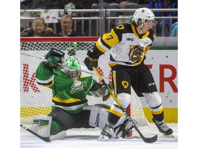 Brett Brochu of the Knights gets knocked into the net by Jake Gravelle of the Bulldogs as the London Knights host the Hamilton Bulldogs at Budweiser Gardens on Friday Jan. 24, 2020.  (Mike Hensen/The London Free Press)