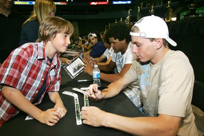 David Mendham, 7, watches as London Knights leading scorer Patrick Kane signs his stick during the London Knights open house in February 2007. (Sue Reeve/The London Free Press)