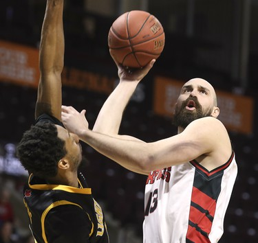 Marcus Capers, left, of the London Lightning pressures Mike Allison of the Windsor Express during their game on Wednesday, February 26, 2020 at the WFCU Centre in Windsor, ON. (DAN JANISSE/The Windsor Star)