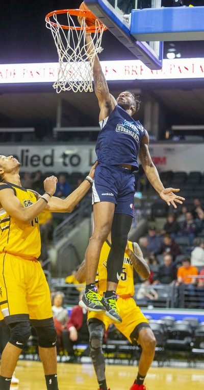 Mareik Isom and AJ Gaines of the London Lightning can only watch as Joel Kindred of the Halifax Hurricanes lays it in for two during their Sunday afternoon game at Budweiser Gardens in London.  Photograph taken on Sunday February 9, 2020. Mike Hensen/The London Free Press/Postmedia Network