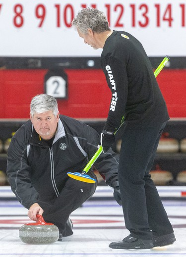 Bob Armstrong delivers a rock in the second end of his team's senior men's provincial championship match Sunday at the St. Thomas Curling Club. The Armstrong rink out of Ingersoll faced Howard Rajala of Rideau, who scored three in the first end and then held on for a 7-5 win over the local rink. Mike Hensen/The London Free Press/Postmedia Network