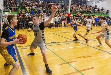 """Beal's Coby Harvey tries to inbound against Laurier's Spencer Kanters after a huge Laurier basket late in the fourth making the score 47-46 for Beal during their WOSSAA AAA senior boys semi-final played at home on Wednesday February 26, 2020. Last week in the city final, Beal won 79-59, but Beal coach Brian Harvey said, """"it's tough to beat a team twice in a row, and their home gym is worth 10pts."""" And it was, after trailing throughout the first half, a rousing third quarter had the teams tied at 33 heading into the fourth. The fourth didn't disappoint with Laurier's raucous home gym keeping the team fired up, with Beal leading 47-46 with 4.4 seconds to play, a basket made it 49-46 with 3 seconds and then a technical foul made it 50-46 for the final. Beal will face CCH in the WOSSAA AAA final. Mike Hensen/The London Free Press/Postmedia Network"""