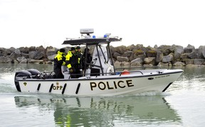 The OPP's underwater search and recovery unit leaves Harbour Marina in Port Dover in search of a man who fell off a fishing tug about 15 kilometres west of Long Point. Photo taken March 25, 2020. (Monte Sonnenberg, Postmedia Network)