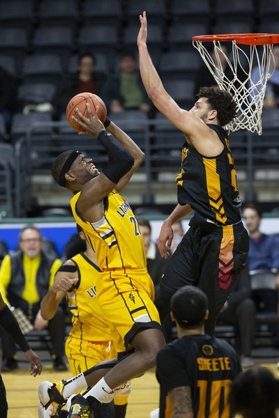The London Lightning's Abednego Lufile shoots while covered by Brady Skeens of the Sudbury Five during their NBL game at Budweiser Gardens in London on Wednesday. (Derek Ruttan/The London Free Press)