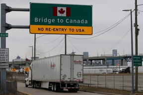 A commercial truck heads for the Ambassador Bridge, during the coronavirus disease (COVID-19) outbreak, at the international border crossing, which connects with Windsor, Ontario, in Detroit, Michigan, U.S., March 18, 2020.      REUTERS/Rebecca Cook ORG XMIT: GGG-DET10