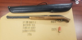 London police seized a rifle and ammunition from a Marconi Boulevard home on Thursday. A man is charged. (London police photo)