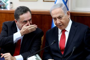 FILE PHOTO: Israeli Prime Minister Benjamin Netanyahu listens to Foreign Minister Israel Katz during the weekly cabinet meeting in Jerusalem October 27, 2019. Gali Tibbon/Pool via REUTERS/File Photo ORG XMIT: FW1