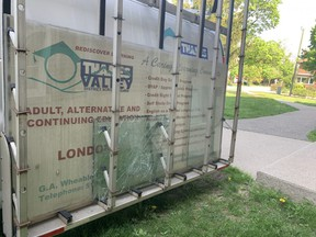 A Thames Valley District school board truck loaded with two broken window panes was parked outside London South Collegiate Institute on Monday. DALE CARRUTHERS / THE LONDON FREE PRESS