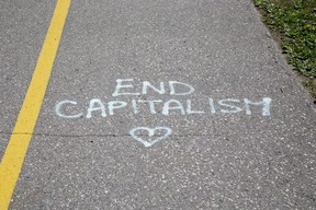 Several messages in spray paint have appeared on the road and bike path in Greenway Park  in London, Ont. Photo shot on Thursday May 21, 2020. Derek Ruttan/The London Free Press/Postmedia Network