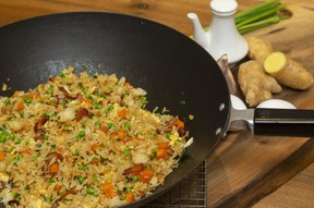 Chinese-style fried rice can easily be adapted to Thai or Indian flavours. (Mike Hensen/The London Free Press)