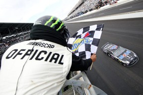 INDIANAPOLIS, INDIANA - SEPTEMBER 08: Kevin Harvick, driver of the #4 Mobil 1 Ford, crosses the finish line to win the Monster Energy NASCAR Cup Series Big Machine Vodka 400 at the Brickyard at Indianapolis Motor Speedway on September 08, 2019 in Indianapolis, Indiana. (Photo by Chris Graythen/Getty Images)
