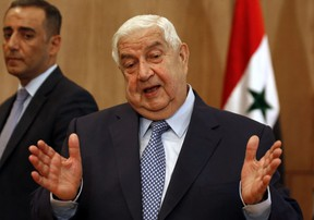 """Syria's Foreign Minister Walid Muallem holds a press conference on new US sanctions imposed on the country, in the capital Damascus on June 23, 2020. - Fresh US sanctions wont push Syria to """"bow"""" to Washington's demands, Muallem said, explaining that they aim to undermine support for President Bashar al-Assad ahead of elections. (Photo by LOUAI BESHARA / AFP) (Photo by LOUAI BESHARA/AFP via Getty Images)"""